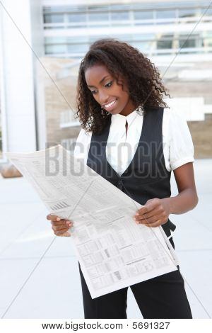 African Business Woman With Newspaper