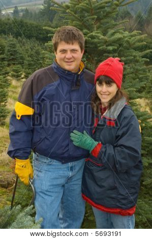 Middle aged couple at Christmas Tree Farm