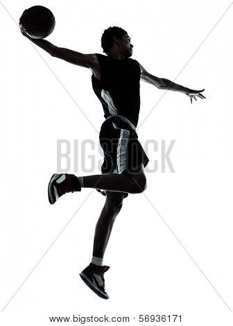 one young man basketball player one hand slam dunk silhouette in studio on white background
