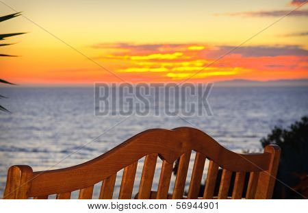 Bench On The Beach At Sunset