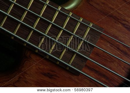 Guitar with brown body on black