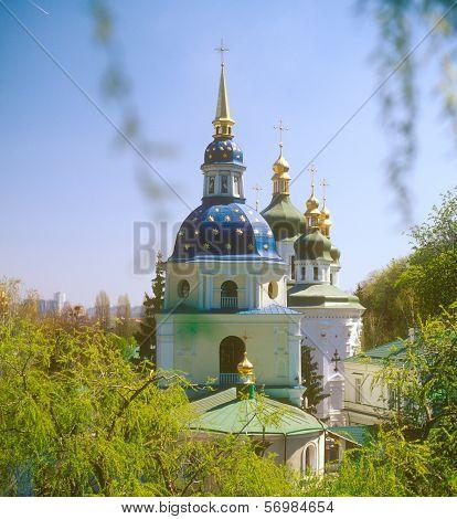 View to the Vydubychi monastery in springtime. Kyiv Ukraine. poster