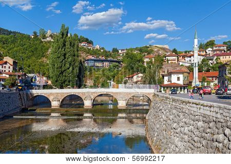 SARAJEVO, BOSNIA AND HERZEGOVINA - AUGUST 11, 2012: Tourists near Latin bridge, the site of the assassination of Archduke Franz Ferdinand by Gavrilo Princip in 1914.
