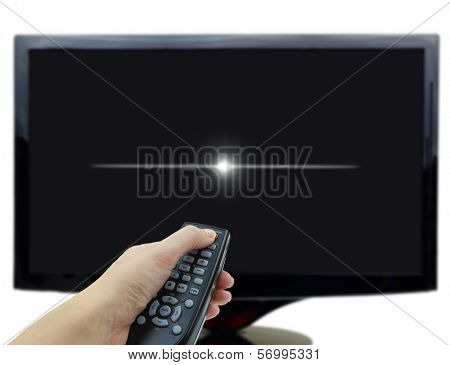Black tv display with hand and remote control