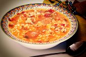Cajun Chicken and Sausage Gumbo in a bowl with spoon and napkin. poster