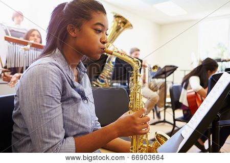 Female Pupil Playing Saxophone In High School Orchestra poster