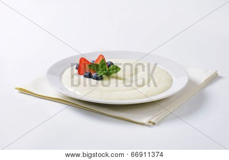 plate of natural semolina pudding with fresh fruit