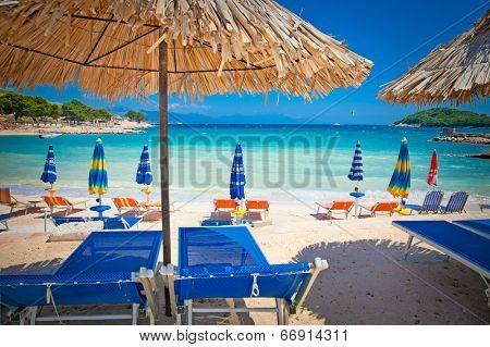 Sunshade umbrellas and deckchairs on the beautiful Ksamil beach, Albania.