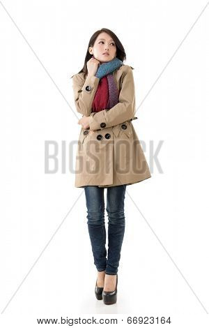 Attractive Asian lady with coat in winter, full length portrait isolated on white background.