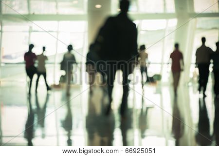 motion business traveler at airport, toned images.