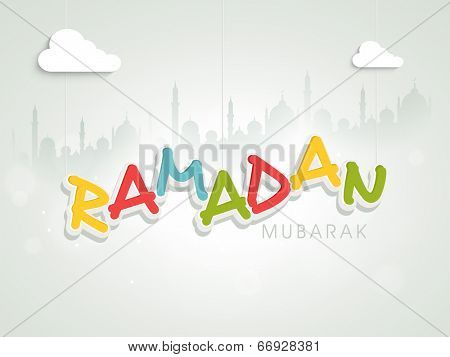 Stylish greeting card design for holy month of Muslim community Ramadan Kareem with colorful text on mosque silhouette background.