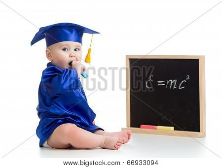 Baby In Academician Clothes  With Chalk At Blackboard