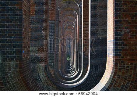 Brick arches on a railway viaduct.