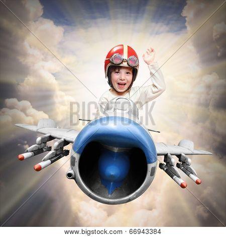 Happy little pilot flying in retro jet fighter.