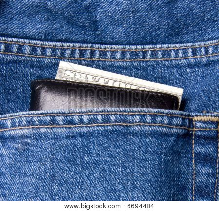Dollar In Pocket Of Blue Jeans