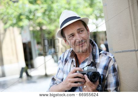 Photographer in town doing a photo reportage