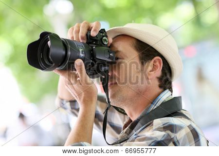 Professional photographer in town taking pictures