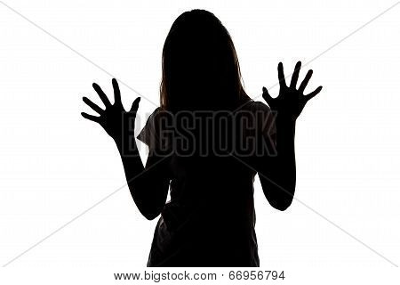 Silhouette of teenager girl with open hands