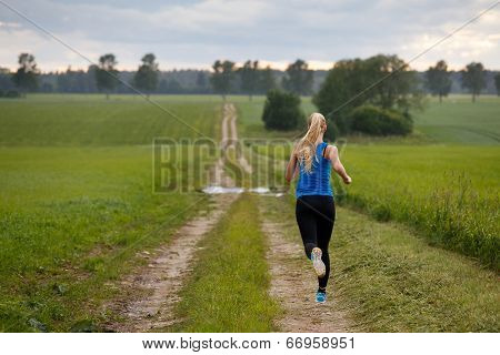 Blonde Woman Running In Nature