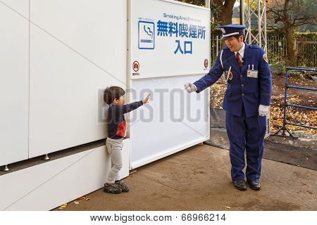 Japanese Security Guard with a young boy