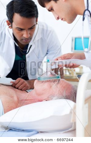 Multi-ethnic Doctors Resuscitating A Senior Patient