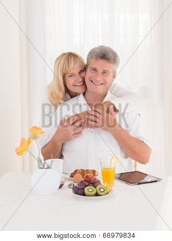 Romantic Happy Mature Couple With Beautiful Smiles Hugging On Breakfast