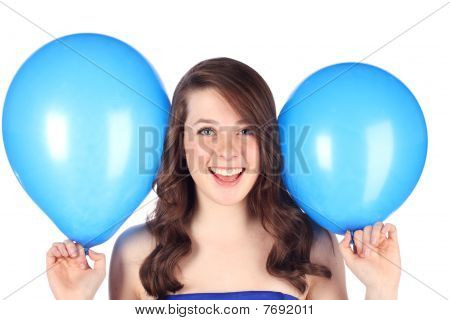 Teen with blue balloons