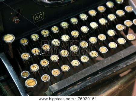 very antique typewriter with white keys very old keyboard