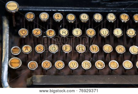 ancient rusty typewriter with white keys very old