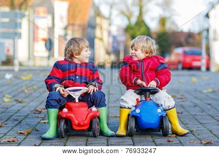 Two Happy Friends Boys Playing With Big Old Toy Car, Outdoors