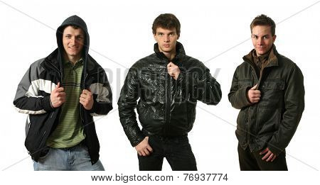 Three young sexy men in winter clothes isolated on white