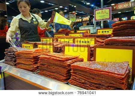 Shop-keeper Sells Assortment Of Chinese Preserved Meat In Macau