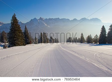 Early morning on slope on the skiing resort Flumserberg. Switzerland