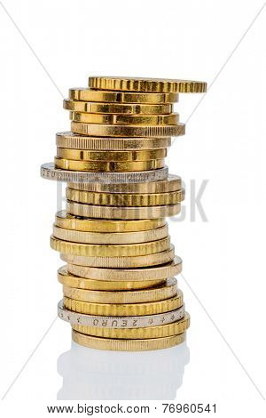 stack of money coins in front of white background, symbol photo for saving, thrift, small savers