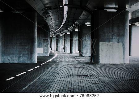 Urban background with big road bridge. Dark contrast colors.