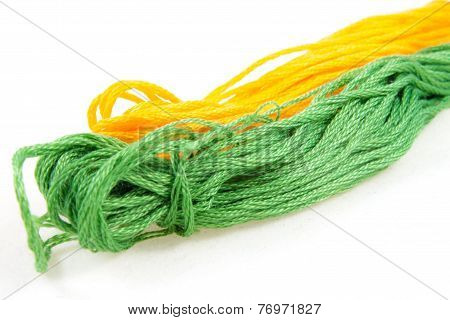Two Balls Of Cotton Green And Yellow
