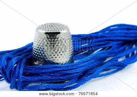Soft Blue Cotton Thread And A Thimble