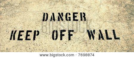 Danger keep off wall