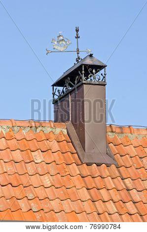 Decorative Chimney Smokestack On Tile Roof