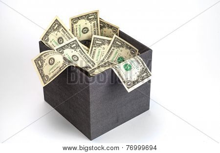 Plenty of US Dollar currency notes are spilling out of gift box