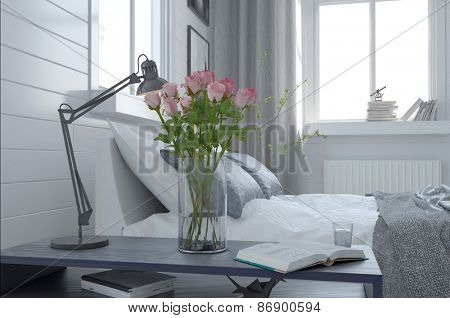 Pretty vase of fresh pink roses in a modern bedroom interior standing alongside an anglepoise lamp on the bedside table. 3d Rendering