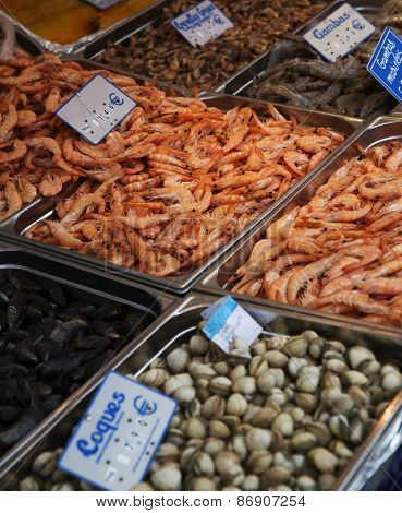Large Group of Shrimps and mussels at the Seafood market in Paris