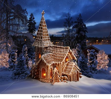 Gingerbread Church On Snowy Christmas Night Landscape