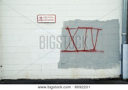Graffiti On White Brick Wall