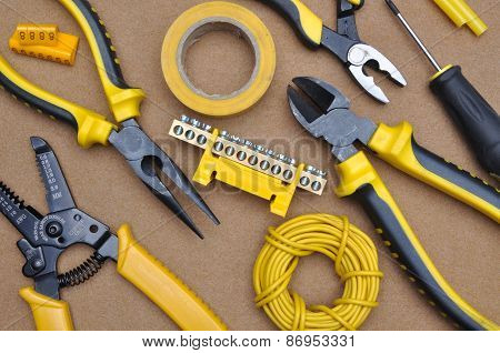 Tools for electrical installation on brown felt poster