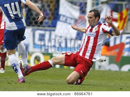 BARCELONA - MARCH, 14: Diego Godin of Atletico Madrid during a Spanish League match against RCD Espanyol at the Estadi Cornella on March 14, 2015 in Barcelona, Spain