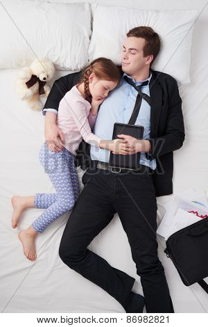 Top view of businessman and his little cute daughter