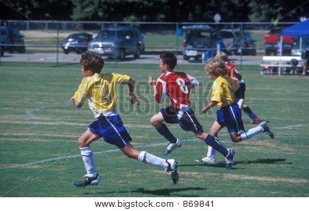 Junior Soccer / Football - Chasing The Ball