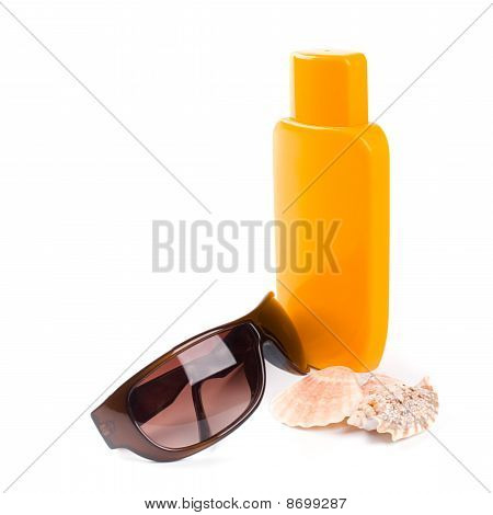 sunglasses shells and lotion closeup on white background poster