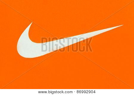 White Nike Logo On Orange Background